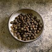 Jamaica peppercorns in an iron bowl