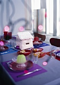 Table laid for Christmas with candy houses