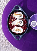 Oysters with smoked ham on cranberries