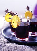 Mulled wine with orange slices studded with cloves