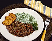 Strips of meat in tomato sauce with rice & platano, Venezuela