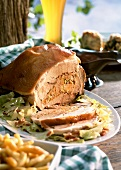Stuffed roast pork neck with white cabbage