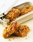 Home-made muesli bars with metal box