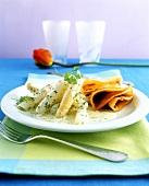 Asparagus ragout with ham pancakes