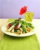 Asparagus with mangetout and pork fillet medallions