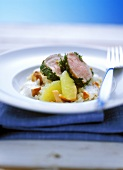 Veal fillet in herb coating on chanterelle risotto