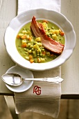 Pea soup with root vegetables, potatoes and belly pork