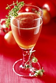 Tomato juice in glass with sprig of thyme