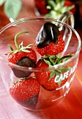 Fresh, chocolate-dipped strawberries in glass cup