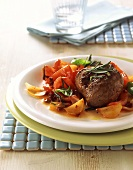 Lamb steak with rosemary on tomatoes