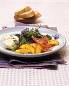 Wild herb salad with peaches, goat's cheese & basil oil