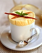 Lemon ice cream soufflé, garnished with caramel sticks