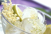 Elderflower ice cubes in a glass bowl
