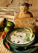 Lemon and coconut soup with fish and asparagus
