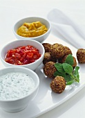 Meat and couscous balls with three different dips