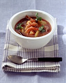 Tomato and orange soup with shrimps