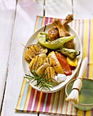 Grill platter with barbecued vegetables and chicken legs