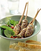 Middle Eastern mince kebabs with spinach salad