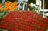 Strawberries with price label on market stall