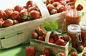Two chip baskets of strawberries, strawberry jam & drink