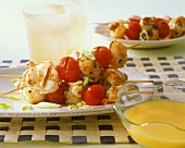Grilled spiny lobster and tomato kebabs