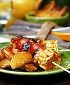 Barbecued vegetable kebabs and country potatoes