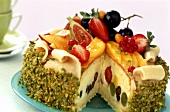 Gateau with fruit, cream and marzipan coating