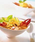 Lobster in Thai stock with lemon noodles and Thai basil