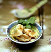 Three wontons (filled Asian dumplings)