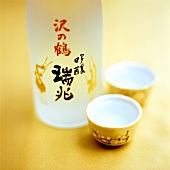 Sake in bottle and sake cups