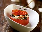 Tomato stuffed with catfish salad