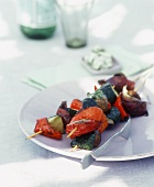 Barbecued vegetable kebabs on a plate