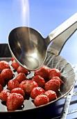 Flambeeing strawberries