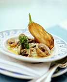 Mussel risotto with guinea fowl breast in sesame coating