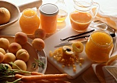 Still life with apricot, orange and carrot jam and ingredients
