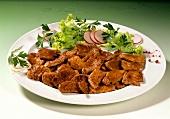 Turkey gyros with salad garnish on plate