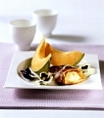 Honeydew melon with Parma ham and goat's cheese rolls
