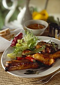 Spare-ribs with barbecue sauce and salad