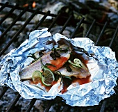 Fish fillet (red gurnard) in foil on barbecue