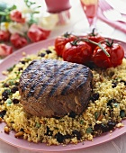 Barbecued filled steak on couscous with raisins & pine nuts