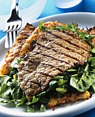 Barbecued steak with salad and potato rosti