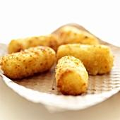 Deep-fried potato croquettes on kitchen paper