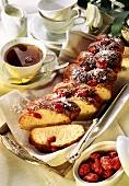 Sweet brioche plait with sugared almonds