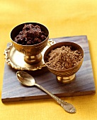 Garam masala as powder and paste in Middle Eastern bowl