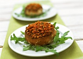 Giant mushrooms with mince stuffing on rocket