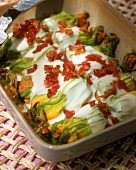 Baked courgette flowers with ham and béchamel sauce