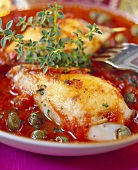 Stuffed cuttlefish on tomato and caper sauce