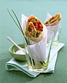 Spicy salami wraps with jalapeno peppers and tomatoes
