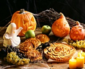 Halloween still life with coiled raisin buns & apple tart