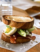 Toasted bacon, lettuce and egg sandwich